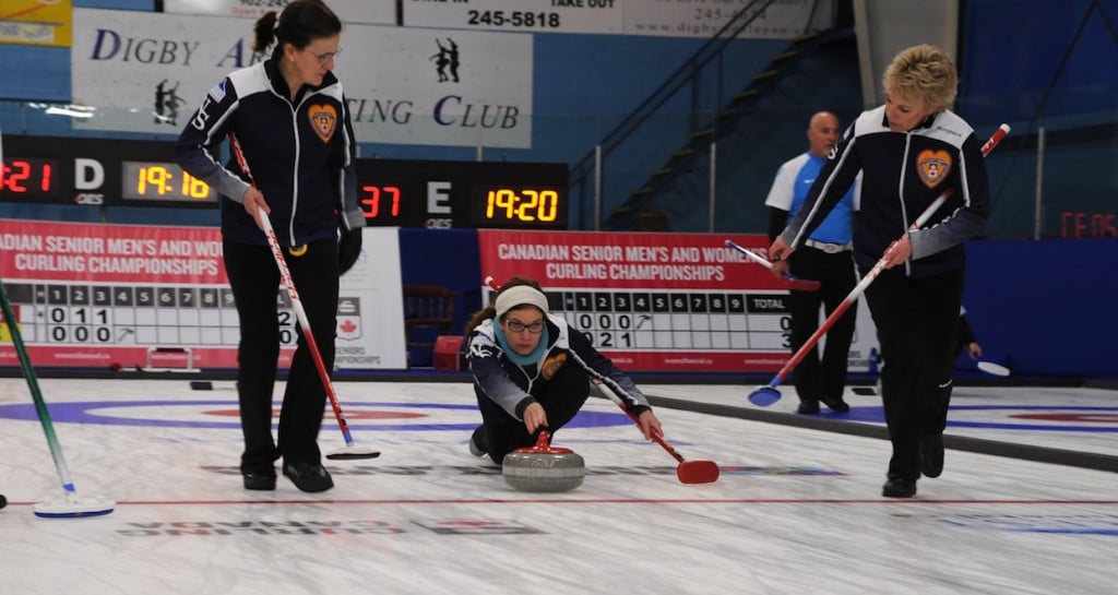 Nova Scotia's Colleen Jones delivers her rock to sweepers Mary Sue Radford and Kim Kelly on the first day of action at the 2016 Everest Canadian Senior Curling Championships (Curling Canada/Mike Lewis photo)