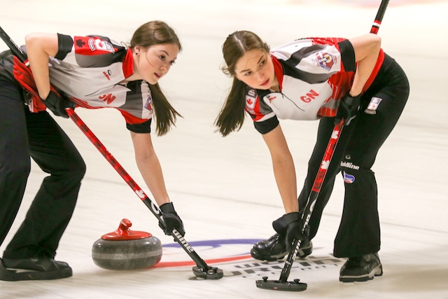 Team Canada lead Janique LeBlanc and second Karlee Burgess look up for sweeping instructions during the first day of action at the 2016 World Junior Curling Championships (WCF/Richard Gray photo)