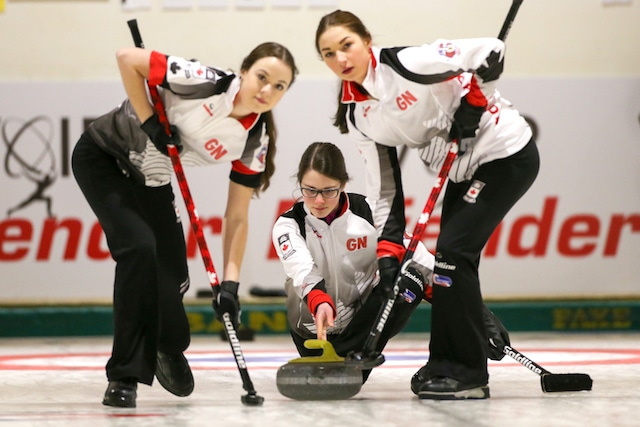 Team Canada's Mary Fay, Karlee Burgess (left) and Janique LeBlanc (right) in action during their 10-4 win over Russia on Monday afternoon in Taarnby, Denmark (WCF/Richard Gray photo)