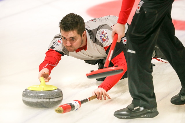 Team Canada skip Matt Dunstone delivers his rock during Day 4 action at the 2016 World Junior Curling Championships in Taarnby, Denmark (WCF/Richard Gray)