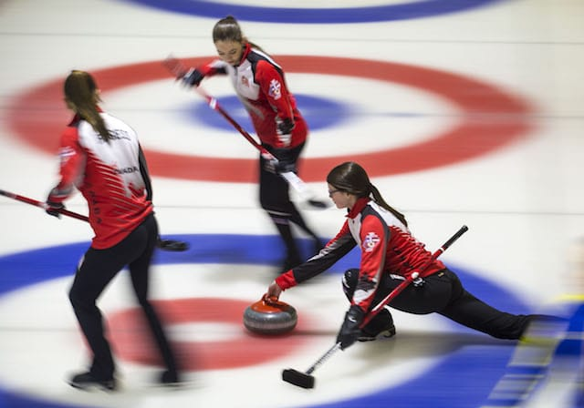 Team Canada's Janique LeBlanc and Karlee Burgess prepared to sweep as skip Mary Fay delivers at the Taarnby Curling Club during the 2016 World Junior Curling Championship (WCF/Marissa Tiel photo)