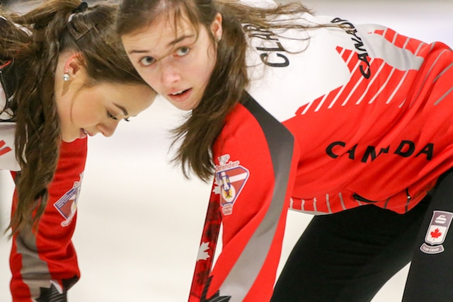 Team Canada's Janique LeBlanc and Kristin Clarke sweep with intensity during action at the 2016 World Junior Curling Championships in Taarnby, Denmark (WCF/Richard Gray photo)