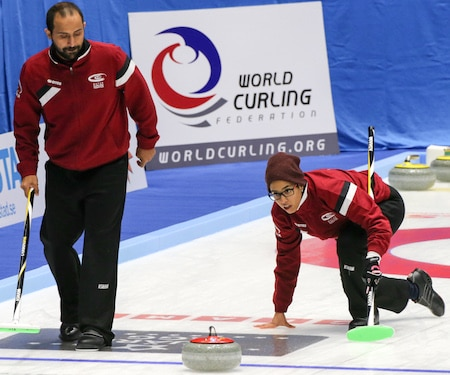 Qatar's Yazid Alyafei, left, and Maryam Binali play in their country's world curling debut on Sunday. (Photo, World Curling Federation/Richard Gray)