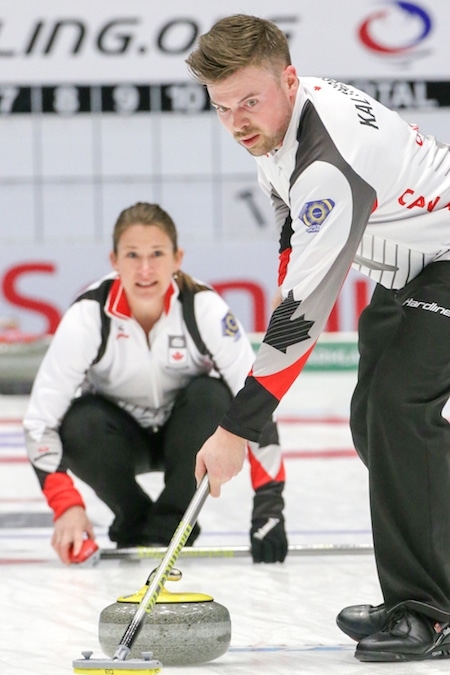Canada's Marliese Kasner, left, looks at her shot as it's being swept by Dustin Kalthoff during Sunday's win over France. (Photo, World Curling Federation/Richard Gray)