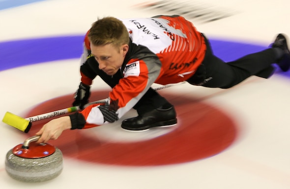 Marc Kennedy delivers a shot during Canada's win over Germany on Tuesday. (Photo, World Curling Federation/Richard Gray)