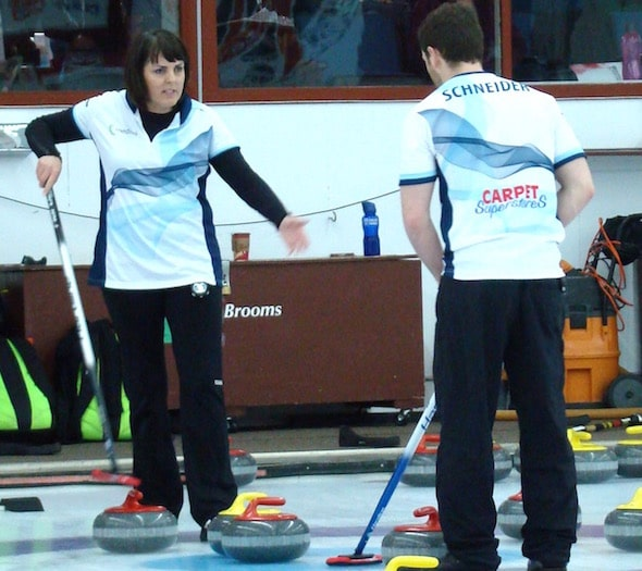 Playoff-bound Nancy Martin, left, and Catlin Schneider plot strategy during the 2016 Canadian Mixed Doubles Championship. (Photo, Darlene Danyliw)