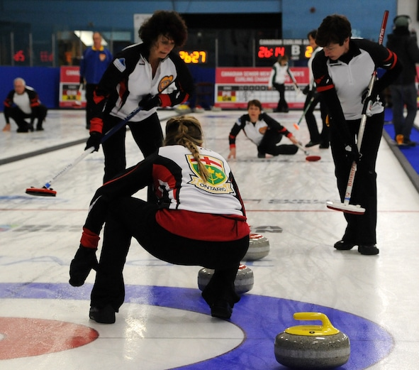 Ontario skip Jo-Ann Rizzo calls the line for second Kristin Turcotte's shot, watched by lead Julie McMullin and third Kerry Lackie during action at the 2016 Everest Canadian Seniors Curling Championships in Digby, N.S. (Curling Canada/Mike Lewis photo)