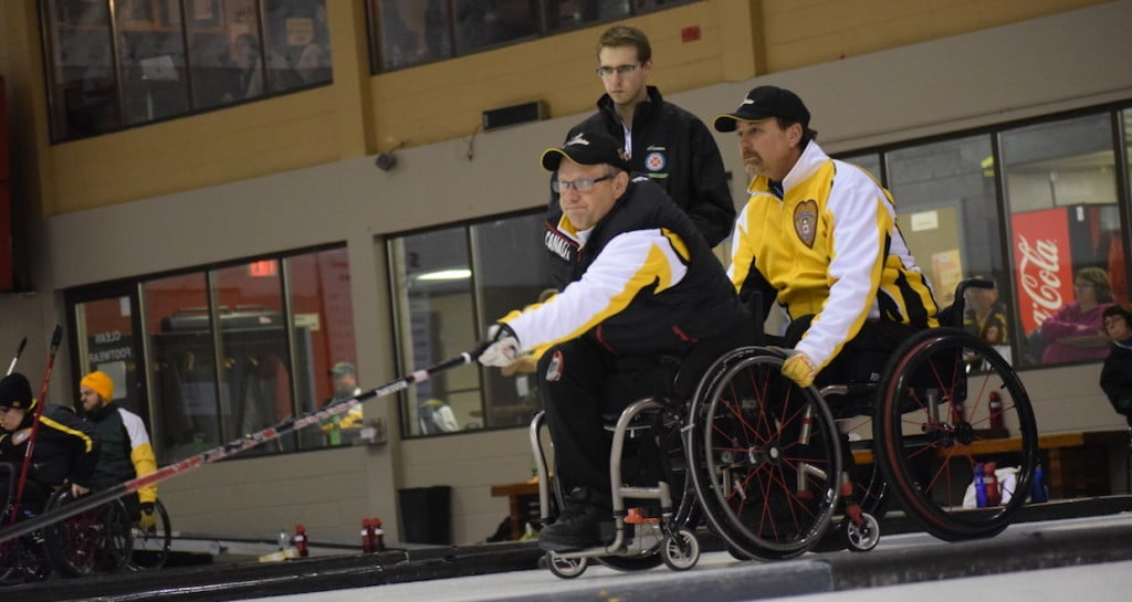 Manitoba's Dennis Thiessen and Mark Wherret in action at the Callie Curling Club in Regina, Sask. during first-day action at the 2016 Canadian Wheelchair Curling Championship (Curling Canada/Morgan Daw photo)
