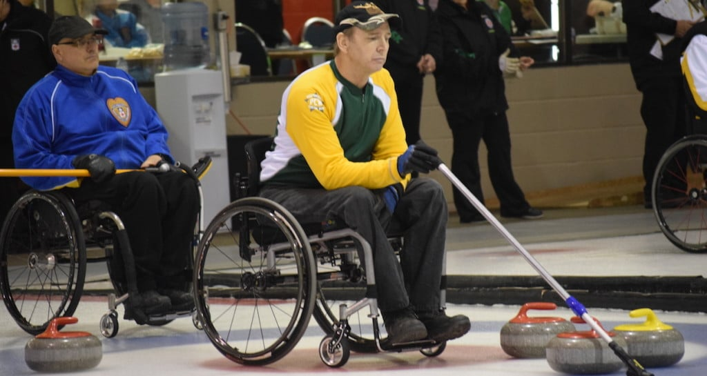 Northern Ontario skip Doug Dean calls the shot during play at the Callie Club in Regina during the 2016 Canadian Wheelchair Curling Championship (Curling Canada/Morgan Daw photo)