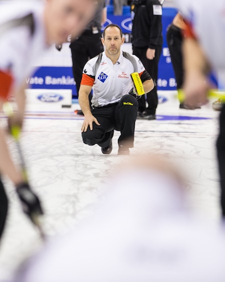 Team Canada second Brent Laing watches his shot's progress. (Photo, World Curling Federation/Céline Stuckli)