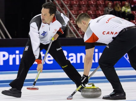Scott Pfeifer, left, got into Wednesday's game against South Korea. (Photo, World Curling Federation/Céline Stuckli)