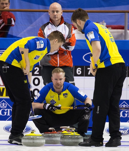 Swedish skip Niklas Edin directs his teammates. (Photo, World Curling Federation/Céline Stuckli)