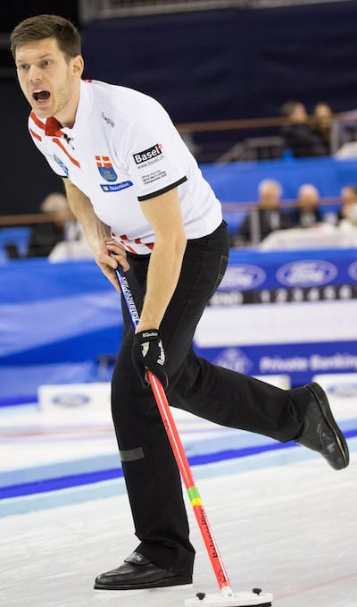 Danish skip Rasmus Stjerne urges on his sweepers. (Photo, World Curling Federation/Céline Stucki)