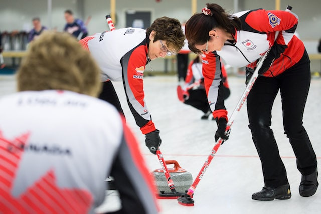 Cheryl Hall and Judy Pendergast bring another rock into the house during action at the 2016 World Senior Curling Championships in Karlstad, Sweden (WCF/Céline Stucki photo)