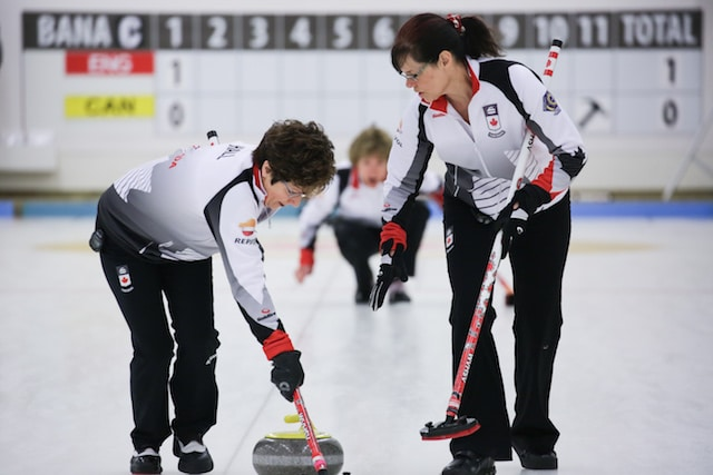 Cheryl Hall and Judy Pendergast in action at the 2016 World Senior Curling Championships in Karlstad, Sweden (WCF/Céline Stucki photo)