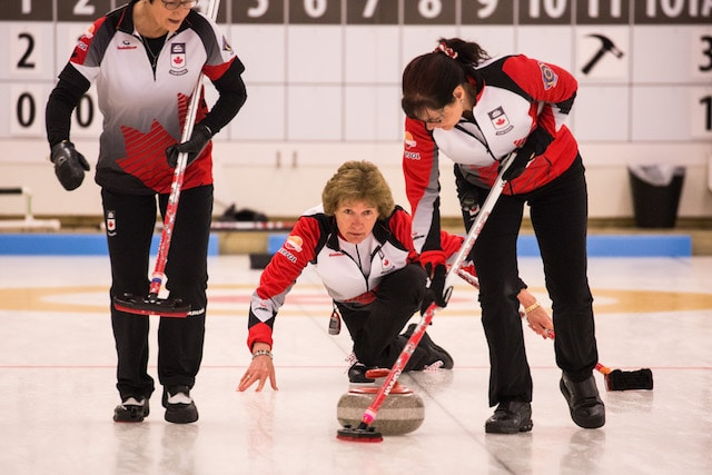 Sweepers Cheryl Hall and Judy Prendergast follow closely as skip Terri Loblaw watches the line during action at the 2016 World Senior Curling Championships in Karlstad, Sweden (WCF/Céline Stucki photo)