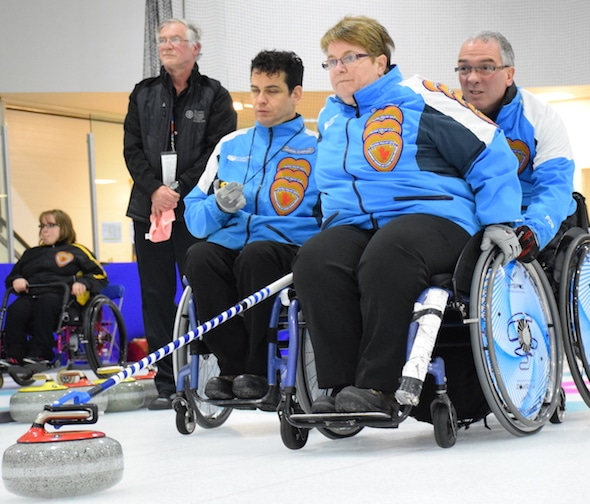 Members of Team Quebec, from left, Carl Marquis, Johanne Daly and Benoit Lessard compete in the 2015 Canadian Wheelchair Championship in Boucherville, Que. (Photo, Curling Canada/Morgan Daw)