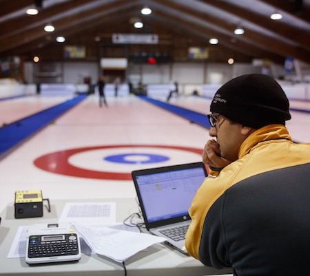 Dr. Louis Poirier analyzes data gathered from the various sweeping tests conducted at the North Grenville Curling Club in Kemptville, Ont. (Photo, courtesy National Research Council/Dan Gamache)