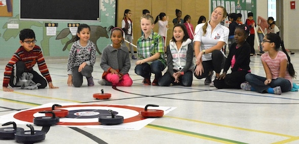 Instructor Kaitlyn Lawes teaches kids the intricacies of curling during an Egg Farmers' Rocks & Rings session