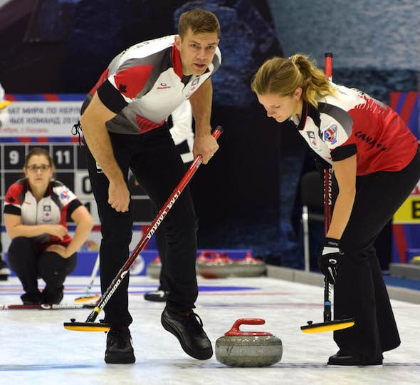 Team Canada sweepers Brad Thiessen, left, and Sarah Wilkes listen for direction after Alison Kotylak's delivery. (Photo, World Curling Federation/Alina Androsova)