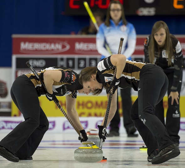 Team Homan (from left, Joanna Courtney, Emma Miskew, Rachel Homan; missing, Lisa Weagle) are looking to cash in this weekend in Portage la Prairie, Man. (Photo, Curling Canada/Michael Burns)
