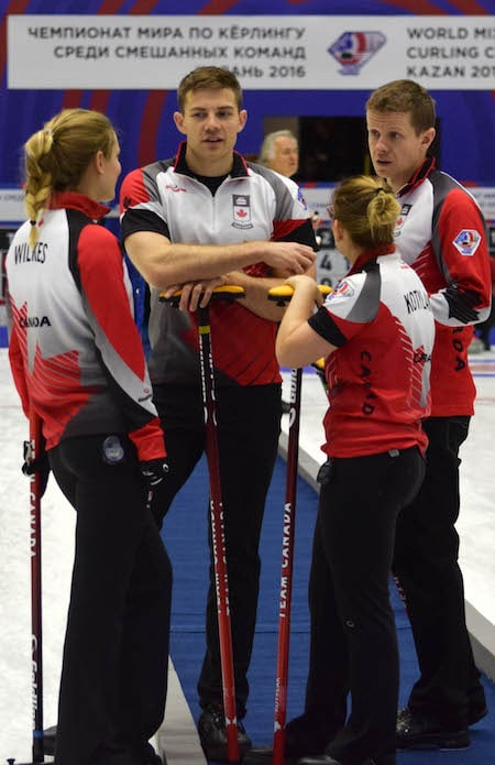 A Team Canada group discussion at the World Mixed Curling Championship. From left, Sarah Wilkes, Brad Thiessen, Alison Kotylak, Mick Lizmore. (Photo, World Curling Federation/Alina Androsova)