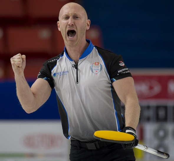 Brad Jacobs celebrates his dramatic game-winning shot against Mike McEwen on Wednesday. (Photo, Curling Canada/Michael Burns)