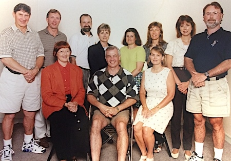 Pat Ray, front, second from left, with the Curling Canada staff back in the day.