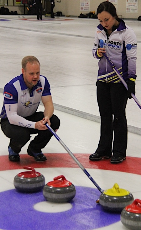 Mark Nichols and Kelsey Rocque ponder their options in action at the Wall Grains Mixed Doubles Classic in Kimberley, B.C. (Photo, courtesy Glenn Hauptman)