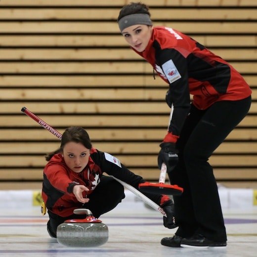 Taylor McDonald and skip Kelsey Rocque in action at the 2014 World Junior Curling Championships, where they won the gold medal (WCF photo)