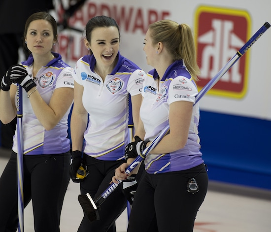 Team Rocque second Taylor McDonald (centre) shares a laugh with teammates Laura Crocker (left) and Jen Gates (right) at the 2015 Home Hardware Canada Cup (Curling Canada/Michael Burns photo)