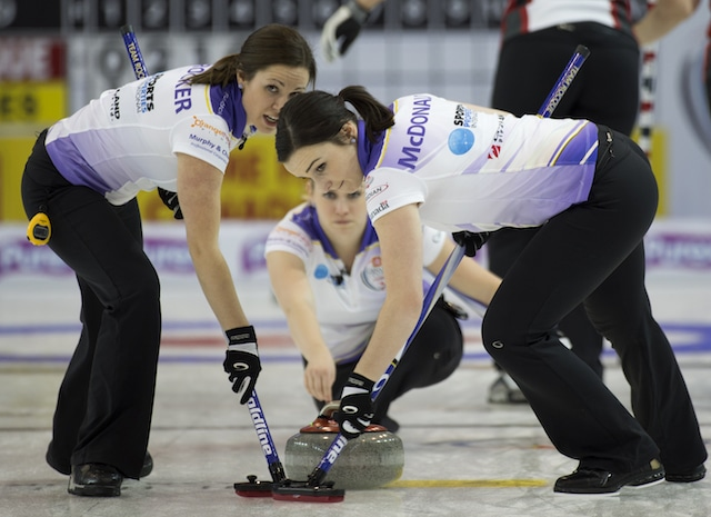 "Taylor McDonald (right) sweeps teammate Jen Gates's rock: ""She's too nice and friendly. I would get a few hits in before she even knew what was going on."" (Curling Canada/Michael Burns photo)"