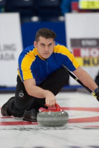 Alberta's Evan Asmussen delivers his rock at the Mariners Centre during the round robin of the 2017 Canadian Mixed Curling Championship (Curling Canada/Robert Wilson photo)