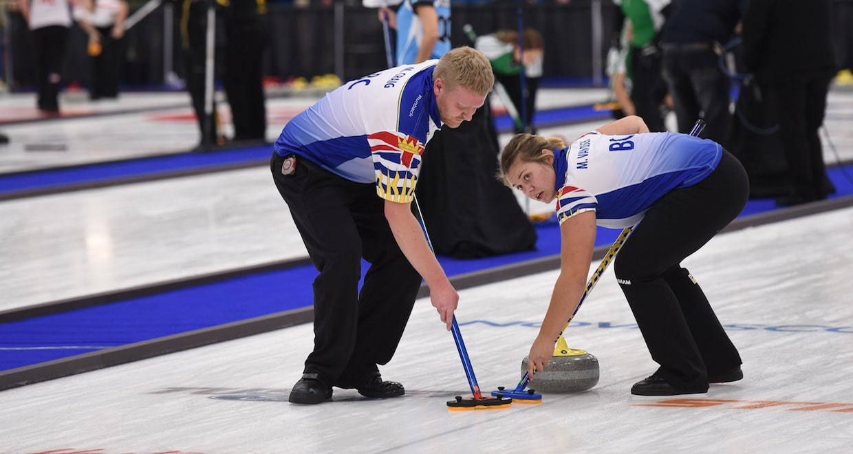 British Columbia second Miles Craig and lead Marike Van Osch sweep a rock down the ice at the Mariners Centre in Yarmouth, N.S., during round robin action at the 2017 Canadian Mixed Curling Championship (Curling Canada photo)