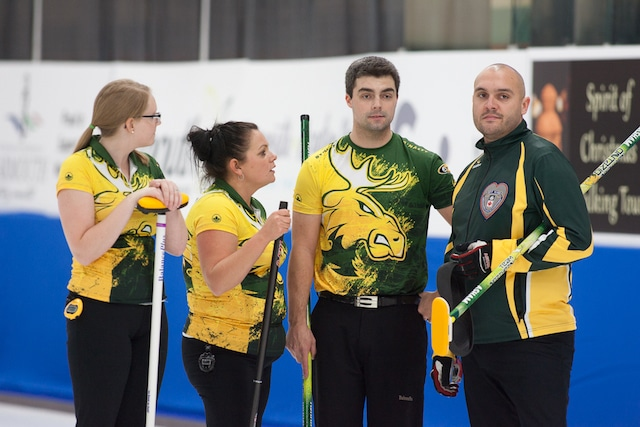 Northern Ontario's Megan Carr, Jackie McCormick, Kory Carr and skip Trevor Bonot talk strategy during action at the 2017 Canadian Mixed Curling Championship in Yarmouth, N.S. (Curling Canada/Robert Wilson photo)