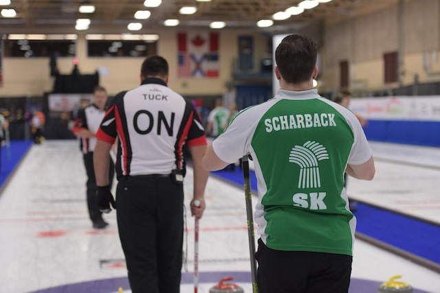 Ontario skip Wayne Tuck and Saskatchewan skip Brady Scharback battle for first place in the final game of the championship round at the 2017 Canadian Mixed Curling Championship in Yarmouth, N.S. (Curling Canada/Clifton Saulnier photo)