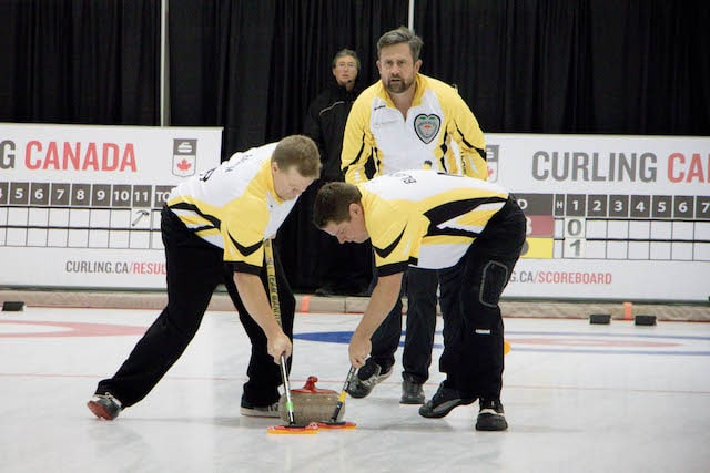 Manitoba skip Andrew Wickman watches the line and sweepers Mark Blanchard and Cam Barth during action at the 2016 Travelers Curling Club Championship in Kelowna, B.C. (Curling Canada/Jessica Krebs photo)