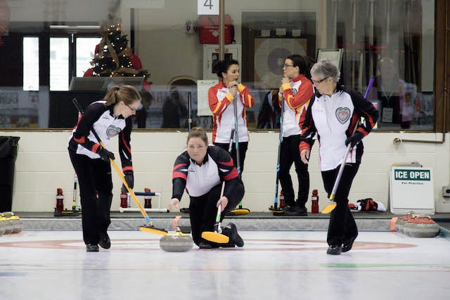 Ontario lead Tracy Hiddink throws her rock as Lisa Jones (left) and Susan Cully, mother of Jones and skip Julie O'Neill, prepare to sweep during action at the 2016 Travelers Curling Club Championship in Kelowna, B.C. (Curling Canada/Jessica Krebs photo)