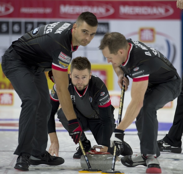 Mike McEwen, middle, and teammates Matt Wozniak, left, and Denni Neufeld picked up a key win on Thursday morning. (Photo, Curling Canada/Michael Burns)