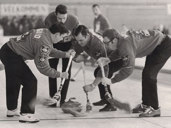 Jim Pettapiece, second from the right, sweeps a rock at the Air Canada Silver Broom with teammates, from left, Don Duguid and Bryan Wood, as Rod Hunter encourages them. (Photo, Michael Burns Sr.)