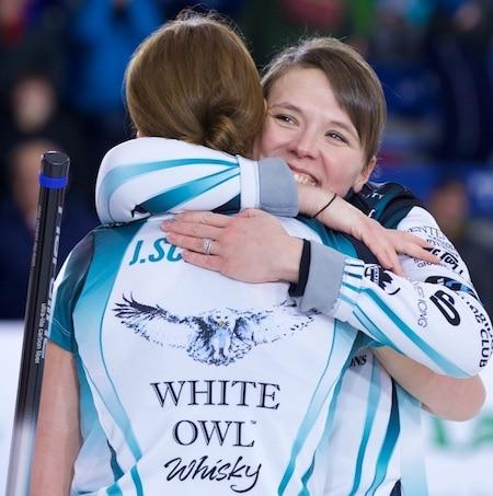 Casey Scheidegger, right, hugs her sister Jesse after their Grand Slam triumph on Sunday. (Photo, Anil Mungal/Rogers Sportsnet)