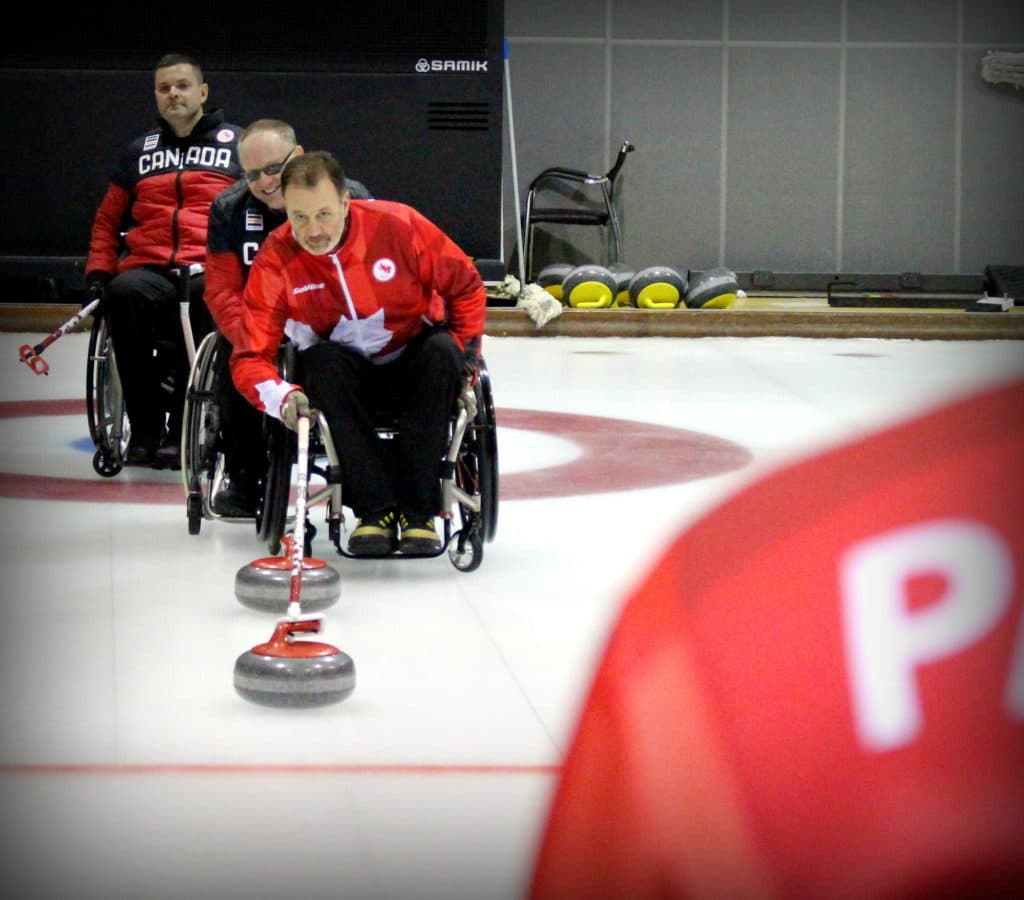 Jamie Anseeuw delivers a rock in practice prior to the 2018 Paralympics (Photo by Brian Chick - Curling Canada).