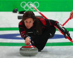 Cheryl Bernard delivers a stone in her opening match at the 2010 Olympic Winter Games