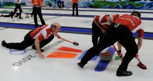 Kevin Martin of Team Canada delivers a rock in his second draw at the 2010 Olympic Winter Games.