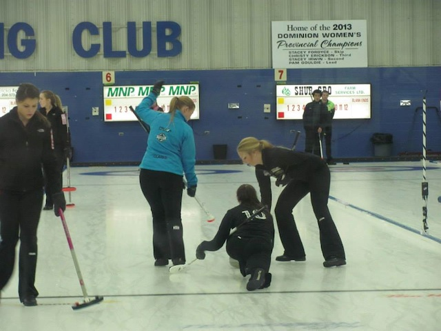 On the ice at the spiel in Brandon, Man. Sarah Sears is throwing, while Taylor Clarke and Mackenzie Proctor sweep (Photo courtesy Taylor Clarke)