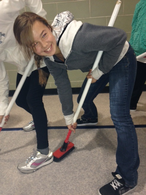 Sweeping practice! (Photo courtesy Rocks & Rings)