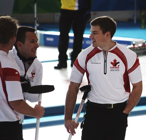 Karrick Martin (left) and Brad Thiessen (right) chat with their Team Canada skip Brendan Bottcher during a break in the action at the Baselga di Pine Ice Stadium in Trentino, Italy (Photo R. Krepps)