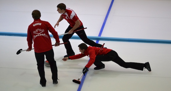 Brendan Bottcher with sweepers Karrick Martin and Brad Thiessen in action at the 2013 Winter Universiade in Trentino, Italy (Photo Mary Beth Challoner)
