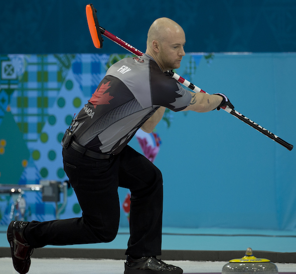 Team Canada vice-skip Ryan Fry urges a Norwegian rock out of the rings during Friday's win over Norway. (Photo, CCA/Michael Burns)