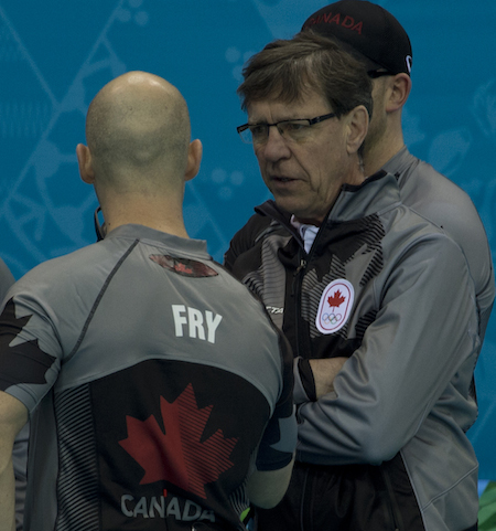 National men's coach Rick Lang, right, speaks with Ryan Fry.